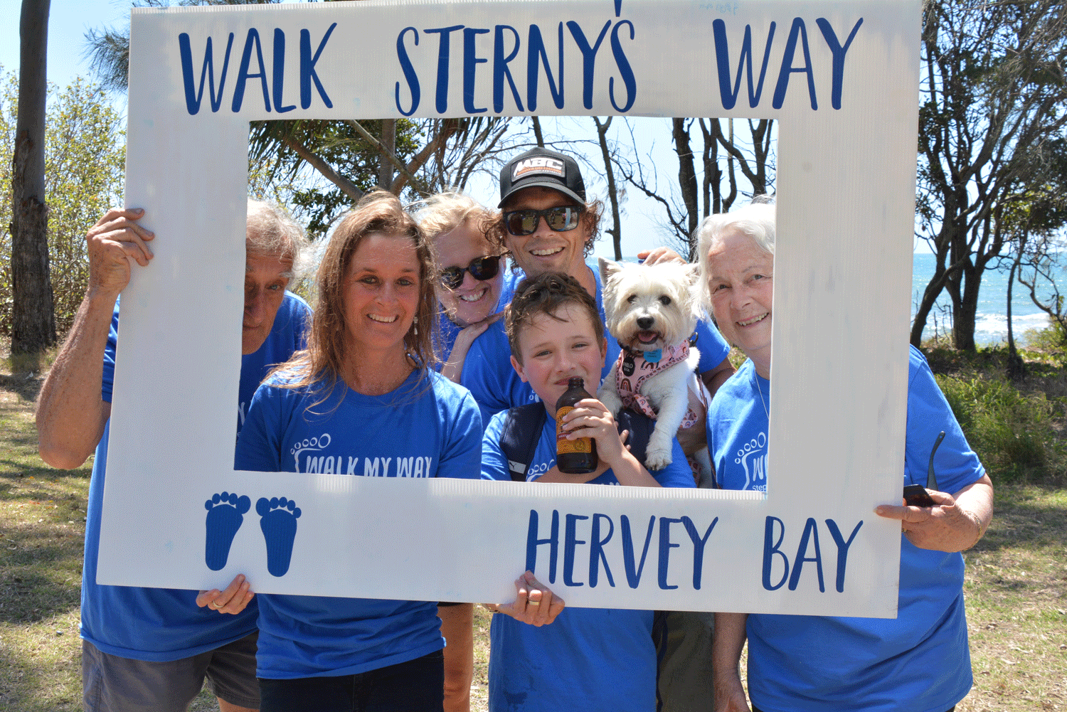 Christian's wife Tanya and son Jasper, with extended family. Jasper told Walkers: 'Dad's vision was to host a walk here in Hervey Bay … I'm proud to be part of it, and I hope you are too.'